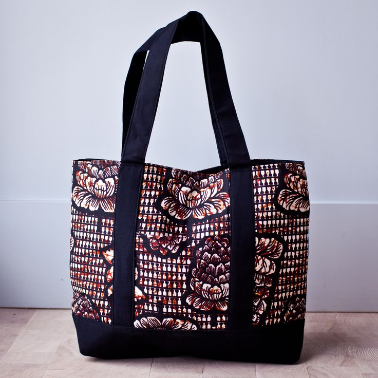 This strong and spacious African tote is perfect for odds and ends. It has one convenient outside pocket and three inside pockets to help you organize and find your items quickly. Black straps, floral