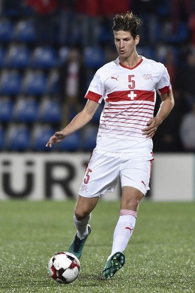 Switzerland's defender Timm Klose runs with the ball during the FIFA World Cup 2018 football qualifier between Andorra and Switzerland on at the Municipal Stadium in Andorra la Vella October 10, 2016. / AFP / PASCAL PAVANI