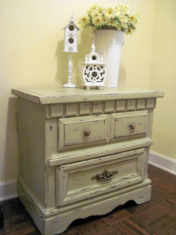 A bed side table painted and distressed