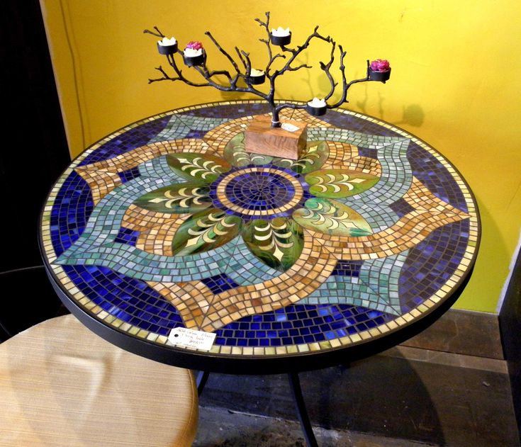 My Grandma had a beautiful mosaic table she made.  It's on my diy before you die list.