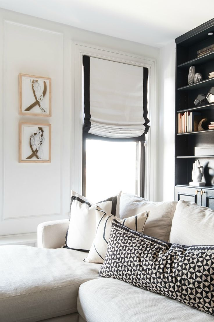 white roman shade with black border white sectional sofa with black