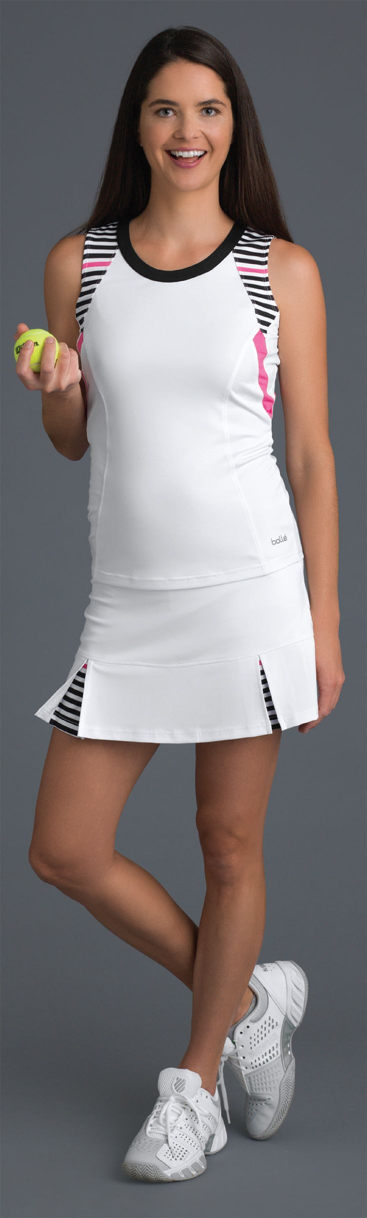 Check out Bolle's Verona women's tennis collection for spring 2018. This premier collection of women's tennis apparel includes tennis skirts, tops, and tanks in hibiscus pink, black, white and verona print fabric for the ideal update to your look for the season. Shop more Bolle tennis and activewear apparel at MidwestSports.com. #tennisskirt