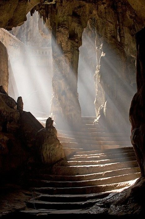 Sun shining into the entrance to the Khao Luang Cave temple, Phetchaburi, Thailand. | © Craig Ferguson