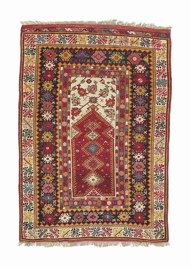 MELAS PRAYER RUG  WEST ANATOLIA, LATE 19TH CENTURY    5 ft. 8 in. x 4 ft. (173 x 122 cm.)