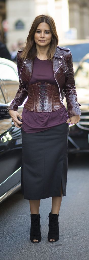 Paris Fashion Week street style: Christine Centenera wearing a maroon leather jacket and matching corset at PFW