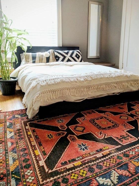 This is an authentic vegetable-dyed handmade rug in excellent condition. The edges show slight wear, but overall still very soft, clean, and rich in color. Beautiful geometric patterns.