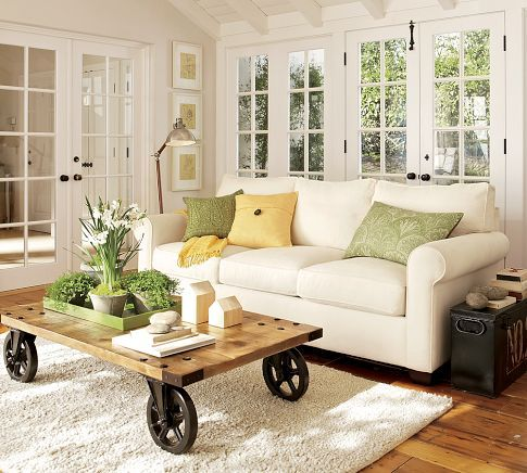 Lovely cottage-style living room with white walls and sofa, lineberry cart, and spring green accents   @covercouch