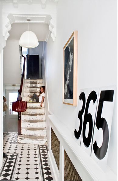 Love this entry hall!...tile...molding...b