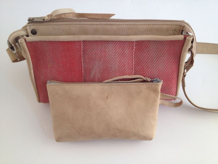 Small shoulderbag, made of used firehose and used leather from the gym