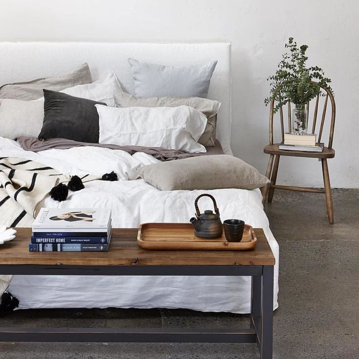 Now who wouldn't want to curl up in this dreamy bed! We love the use of our Warf Bench seat at the end of the bed. Style & function. Regram @yourhomeandgarden