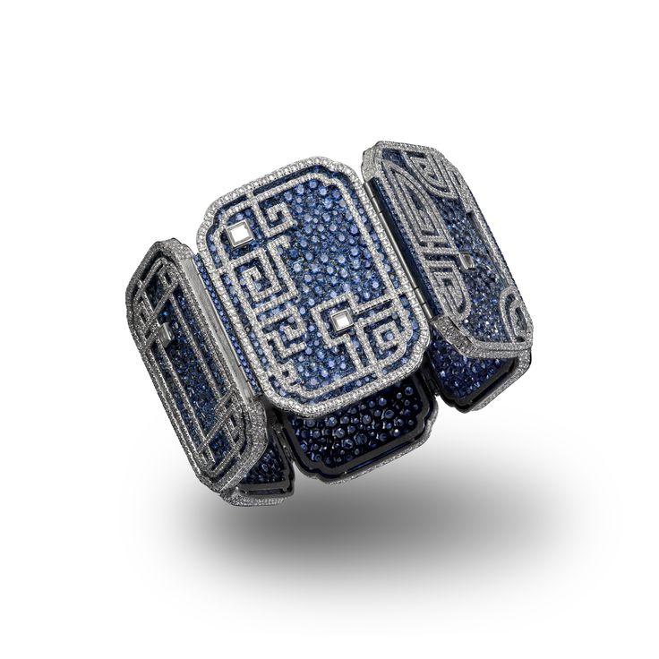 CARNET. A SAPPHIRE AND DIAMOND 'AZURE LATTICE' BRACELET Designed as six pavé-set blue sapphire titanium panels, each embellished with an overlaid diamond-set lattice motif, signed Carnet.