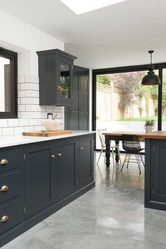 Pantry Blue cabinets with Bella Brass fixtures and knobs, Cararra marble and Iroko worktops and crisp white tiling.