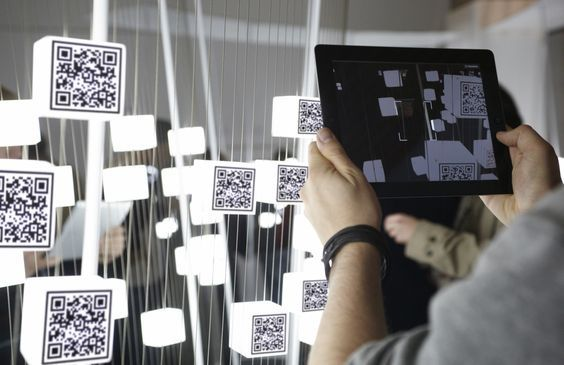 QR codes gamified! What about making each code a prize and that's how event attendees win the raffle prizes?: