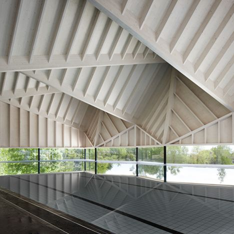 A folded timber roof adds drama to the interior of this school swimming pool in England by Duggan Morris Architects, but also helps to prevent echoes.