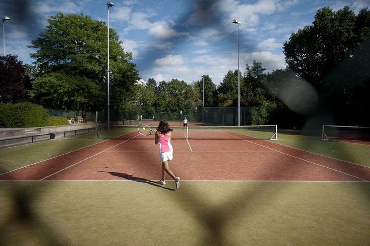 Outdoor tennis courts at Inntel Hotels Resort Zutphen