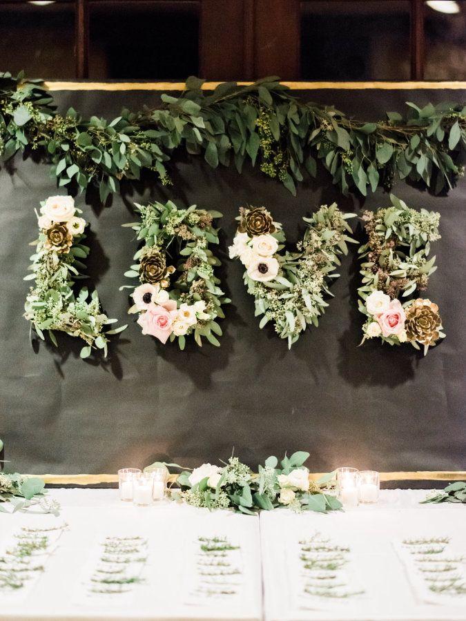 """LOVE"" floral letter backdrop: http://www.stylemepretty.com/california-weddings/san-diego/2016/02/17/glamorous-new-years-eve-wedding-at-rancho-bernardo-inn/ | Photography: Honey Honey - http://hoooney.com/"