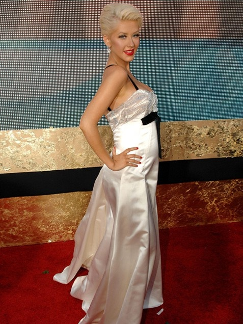"Christina Aguilera at the 2007 Emmy Awards: This ""Dirrty"" singer is probably better known for her racy wardrobe choices. But while pregnant with son Max at the 2007 Emmy Awards, Christina Aguilera chose a rather innocent white satin gown by Valentino."