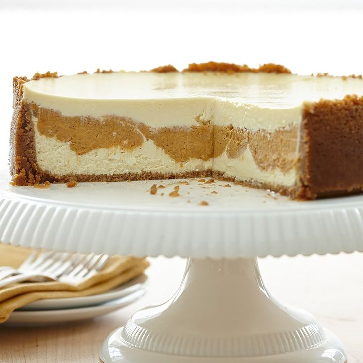 A layer of pumpkin pie filling is sandwiched between layers of vanilla cheesecake for the ultimate holiday dessert.