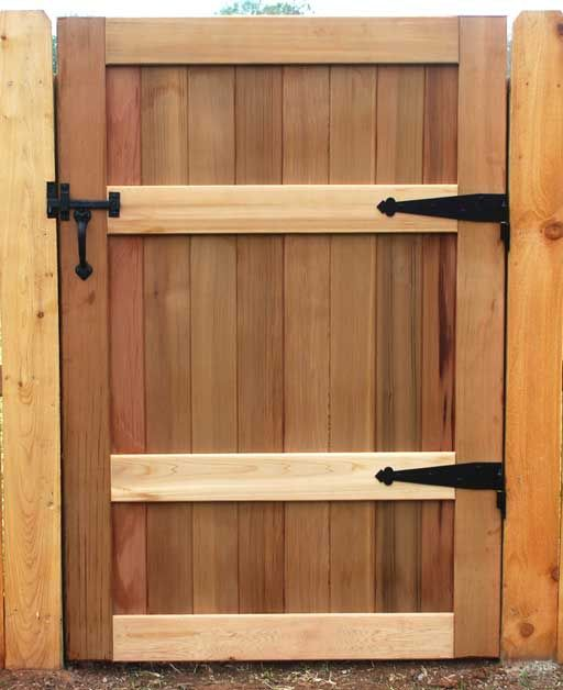 All bronze thumb latch on a wooden gate. See our complete line of solid bronze gate, door, shutter and barn hardware at www.coastalbronze.com.