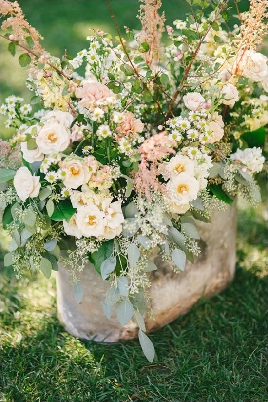wildflower wedding arrangement featured on wedding chicks  Photographer: Honey Honey Photography Venue: The Old Homestead Flowers: Family and Friends
