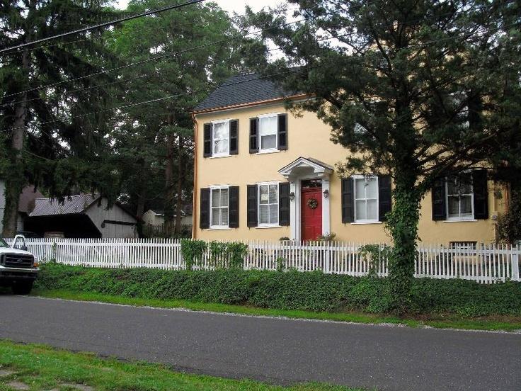Black Shutters White Trim Red Door Yellow House