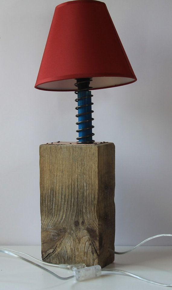 Handmade wooden lamp with red lampshade