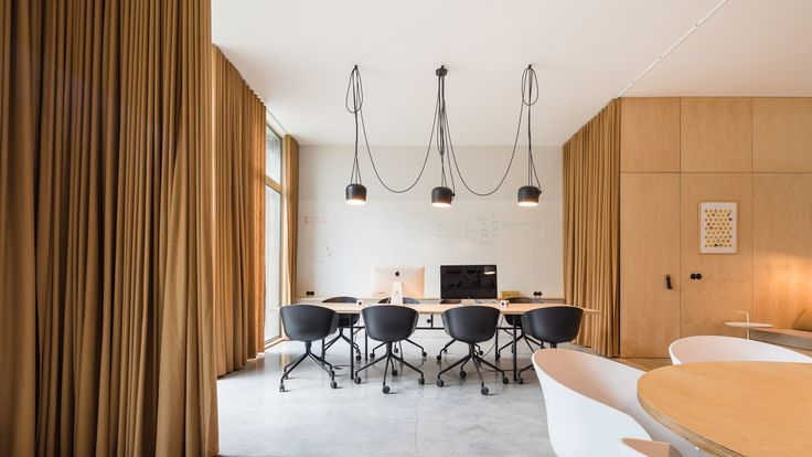 Architects Sílvia Rocio, Mariana Póvoa and Esse Studio have used curtains, patterned tiles and pendant lighting to create this homely office of a mobile dating app in Lisbon, Portugal.