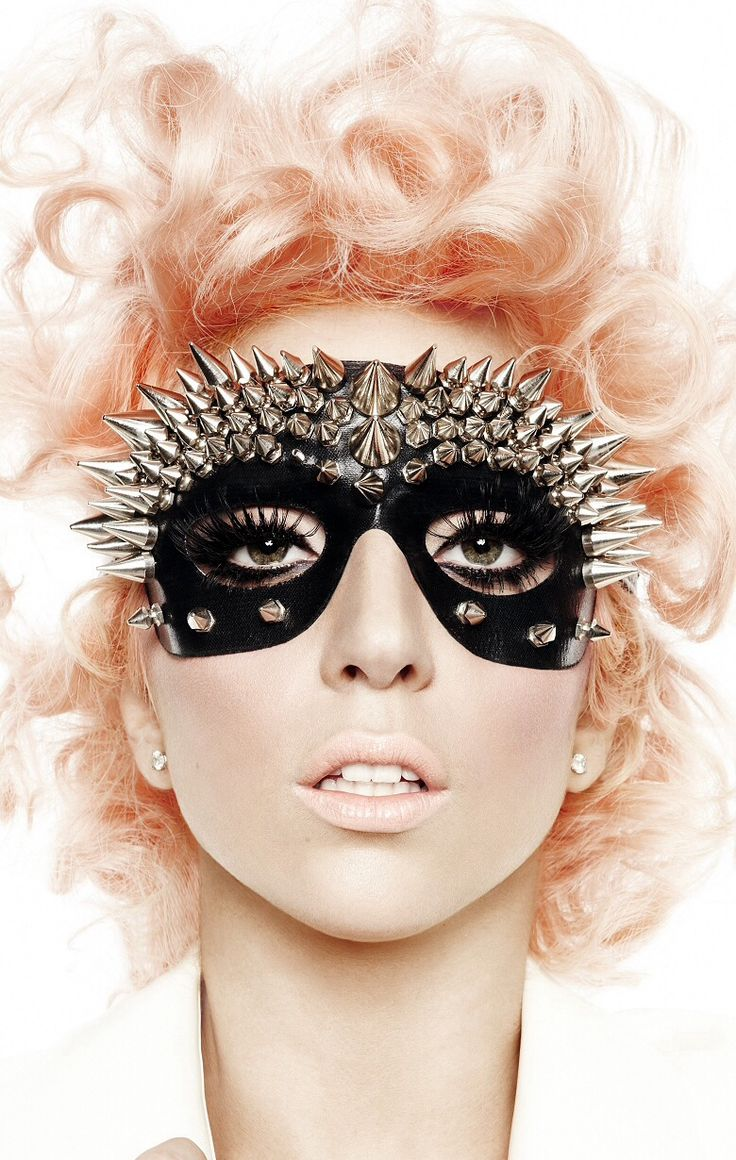 Lady Gaga, for her artistic sensibilities and outrageous style. I'm quite costume/performance oriented so she makes a great muse