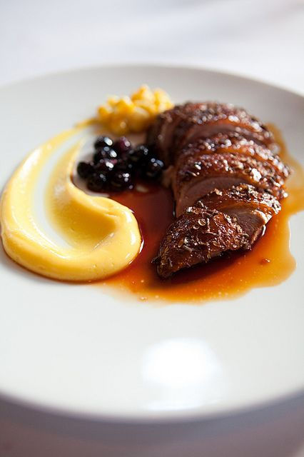 Duck roasted with lavender honey, sweet corn, and blueberries at Eleven Madison Park