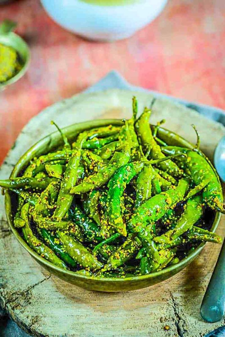 Hari Mirch Ka Achar Recipe or Green Chilli Pickle Recipe goes very well with Indian meals. Here is my mother's recipe to make this pickle.