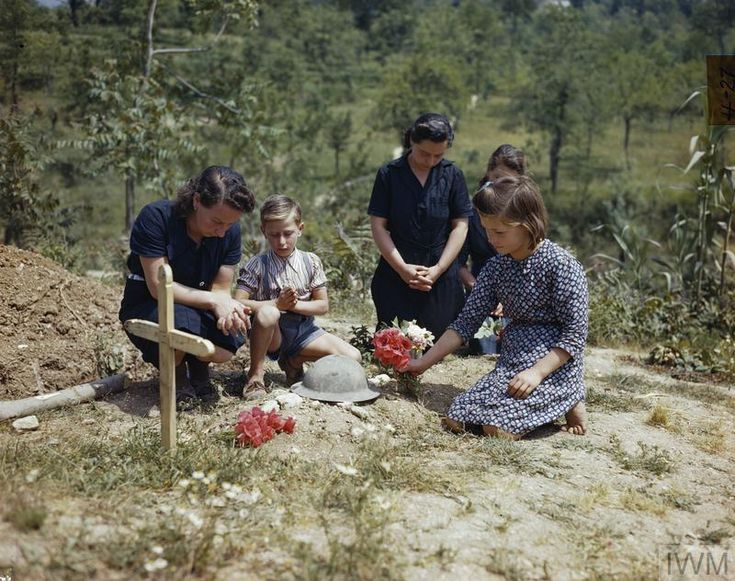 French women and children who were unable to return home from Italy when war was declared, placing flowers on the grave of an unknown British soldier. They did this each day. Outskirts of Monte Cassino, Italy, 19th May 1944. Pin by Paolo Marzioli