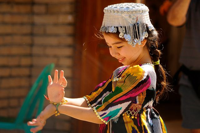 Uzbekistan, Samarkand, Bibi-Khanym Mosque, Uzbek Girl performing traditional dance.   I have a dress just like hers! (and probably the same size :))