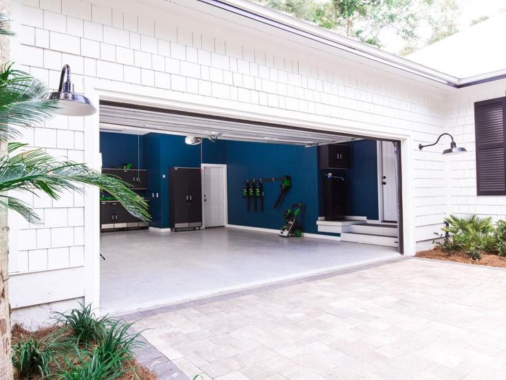 The home's well-organized garage includes a workstation, smart storage solutions and interior walls painted a deep shade of teal for an unexpected pop of color. >> http://www.hgtv.com/design/hgtv-dream-home/2017/garage-pictures-from-hgtv-dream-home-2017-pictures?soc=pinterest