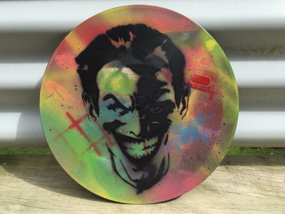 Handmade stencil, spray painted on an upcycled vintage 25cm (10) vinyl record. One off colours, original piece. I can do custom colours, up to two layers