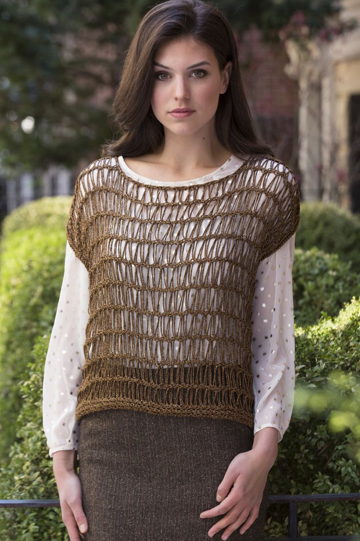 This openwork top is knit sideways, with stitches dropped to create the wide mesh pattern. It's an elegant layering piece that can take any look from day-to
