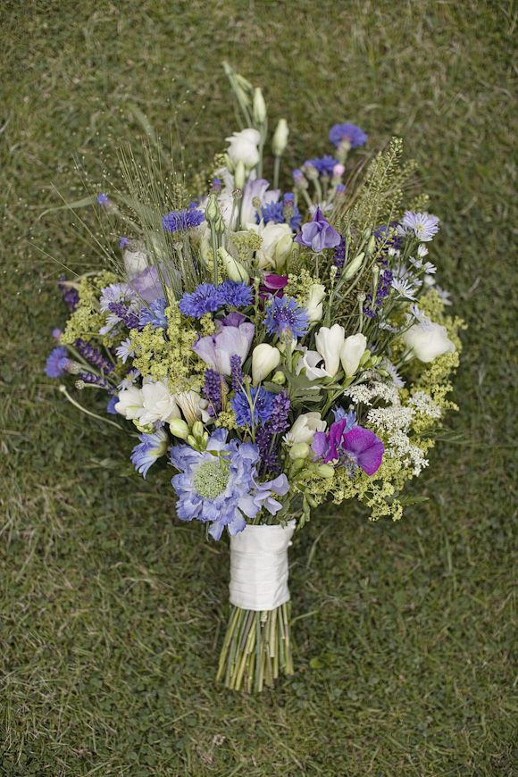 wildflower bouquet- each bridesmaid gets one like this but in their color. so white and different shades of their color