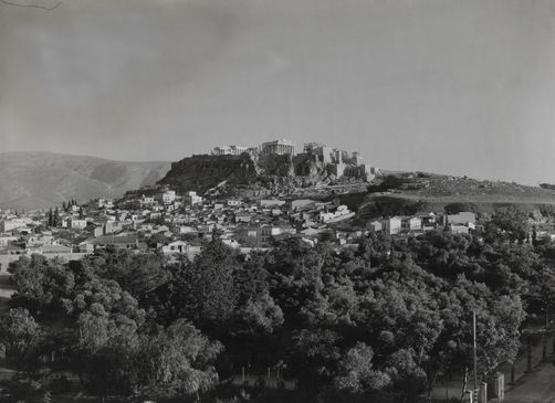 A view of the distant Acropolis seen from the northwest of Athens. 1900s. Location: Acropolis, Athens, Attica Region, Greece. Photographer: FRED BOISSONNAS/National Geographic Creative