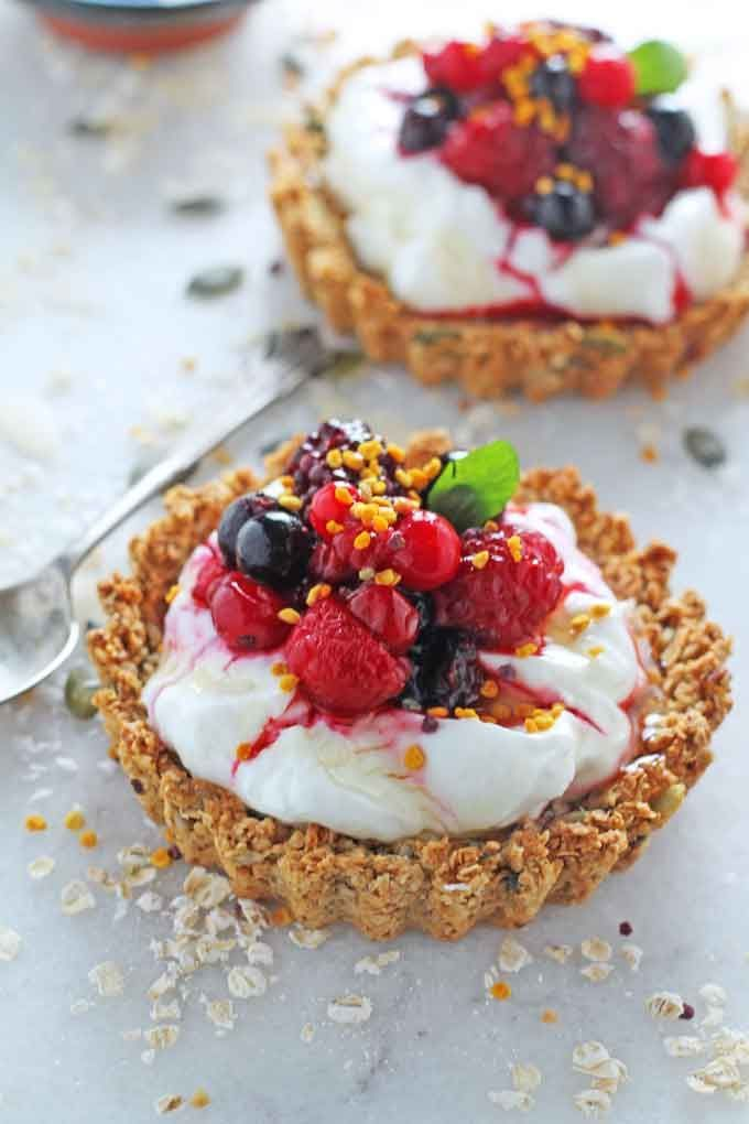 Granola Crust Breakfast Tarts with Yogurt and Berries. A fun way to serve granola and yogurt for breakfast. Gluten free.