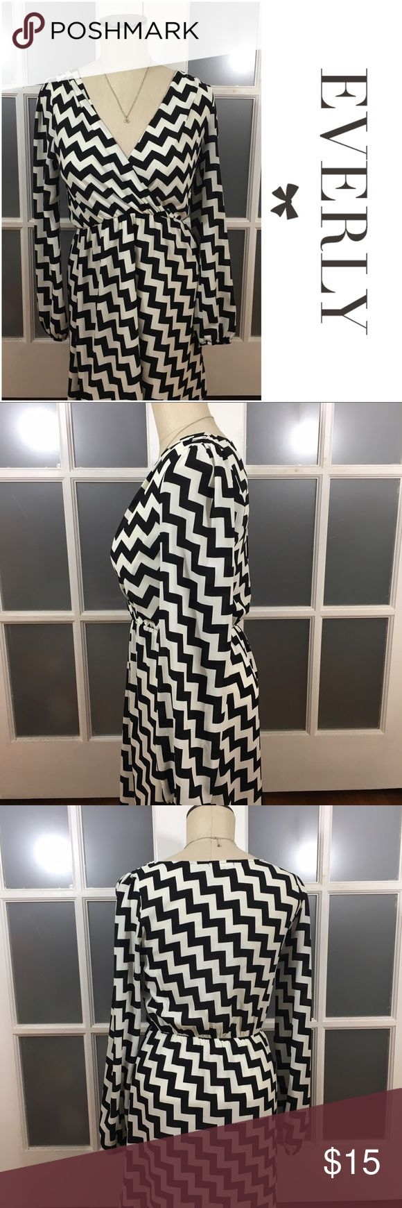 🎉30% OFF BDLS🎉 Everly chevron print dress Everly black and whirman chevron print dress. Lined. Vneck. Long sleeved, sleeves are semi sheer.   🔹Material: 100% polyester   🔹Colors may vary slightly from pictures. 🔹30% off bundles of 2 or more 🔹Accept reasonable offers 🔹No Trades Everly Dresses Long Sleeve