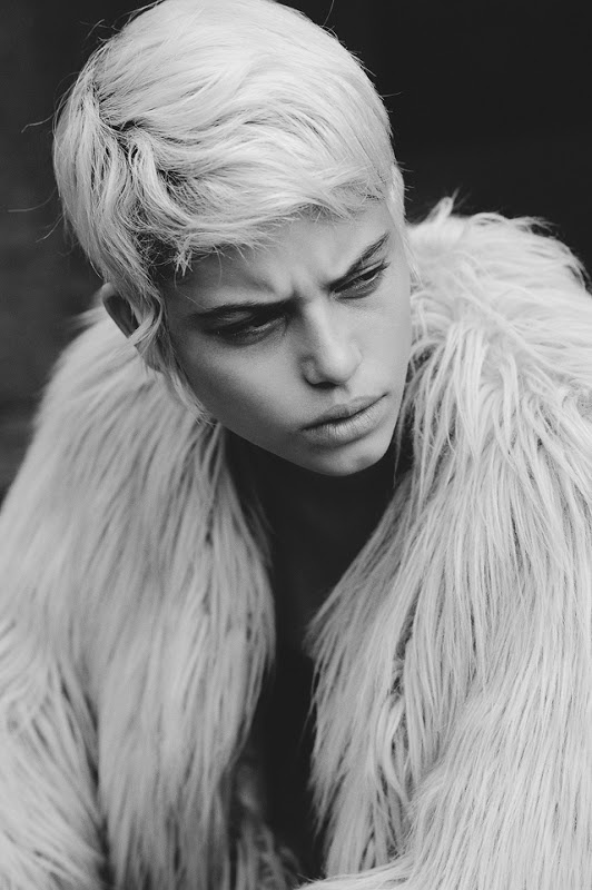 sergey rogov | surly | scowl | blonde | fur | fashion editorial | black & white | photographer | model | eyebrows | frown |