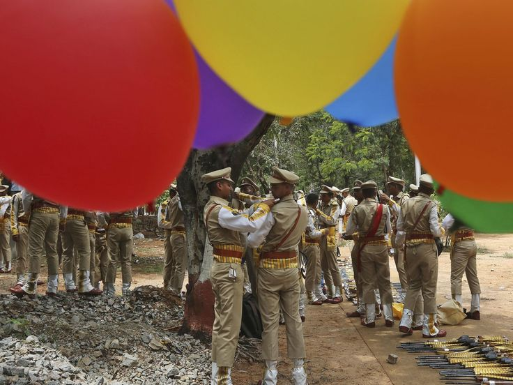 Balloons fly at the National Industrial Security Academy as members of India's Central Industrial Security Force prepare for a ceremonial parade on the outskirts of Hyderabad, India.  Mahesh Kumar A., AP