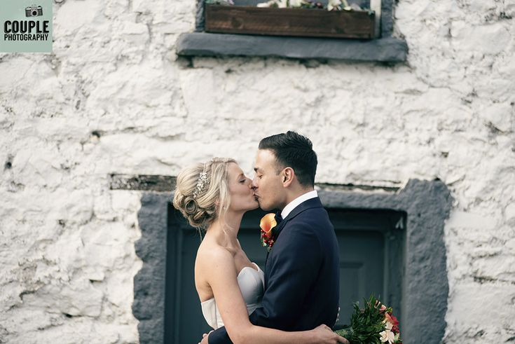 The newlyweds share a kiss. Weddings at Durrow Castle photographed by Couple Photography.