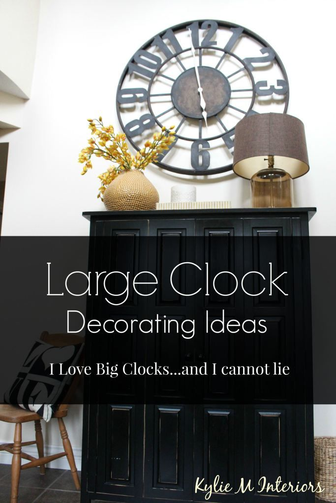 decorating ideas with large or oversized metal or wood clocks in living room entryway