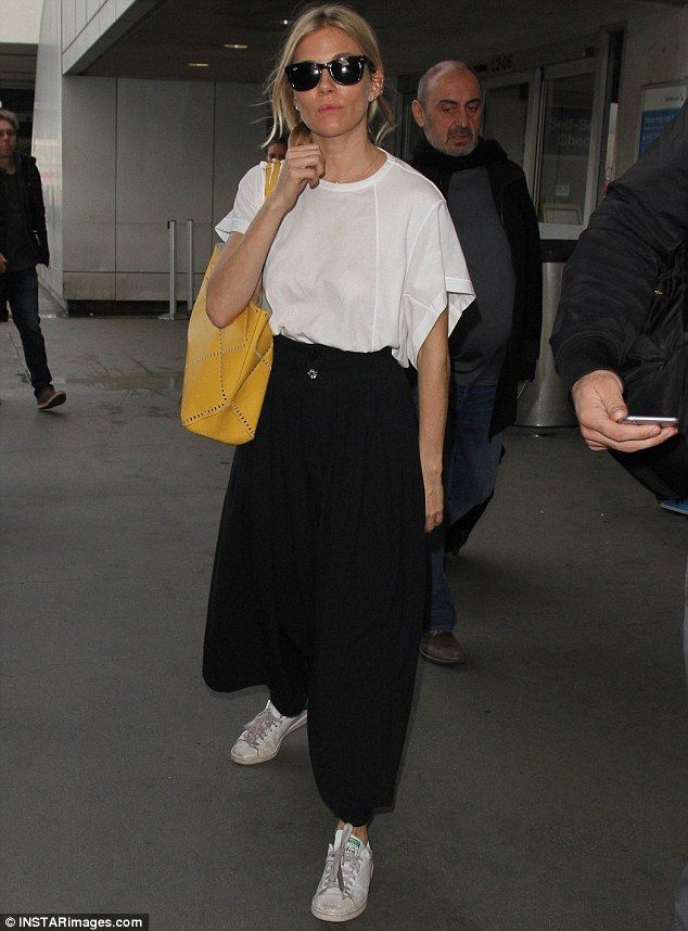 Baggy chic: TrendySienna Miller  wore trendy culottes after touching down in LA on Thursd...