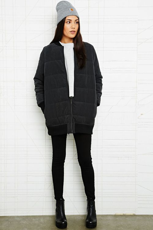 bomber jacket and beanie made feminine with skinnies and chunky heels