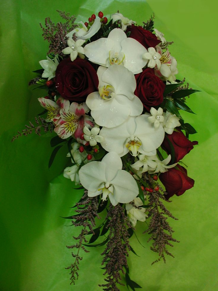 Orchid and roses cascading bridal bouquet