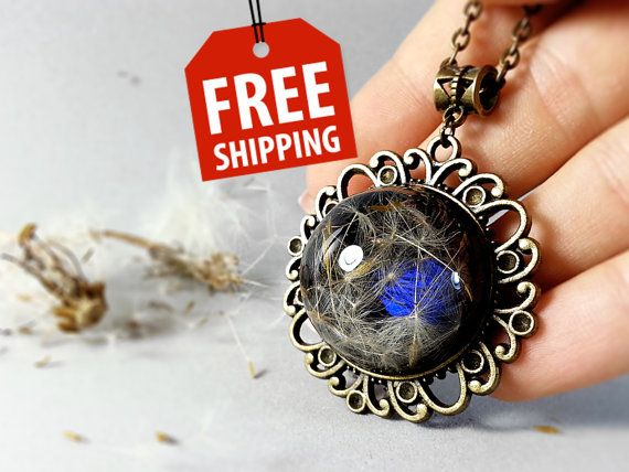 Black and blue Dandelion Botanical necklace by ByEmilyRay on Etsy