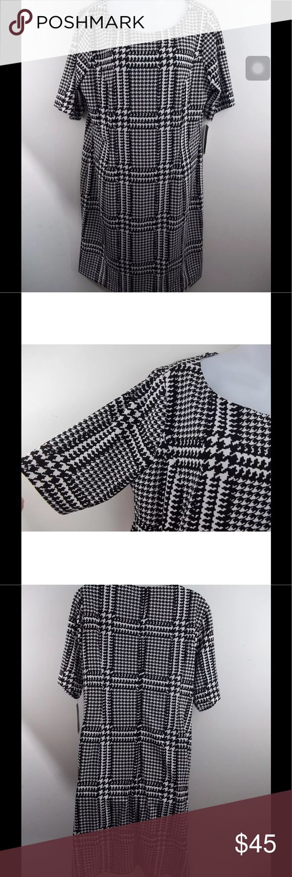 """Alfani Women's Sheath Dress Houndstooth Black NWT Alfani Women's Sheath Dress Black White Macro Houndstooth Print Size 16 NWT   Size: 16 Brand: Alfani Color: Black & White Style: Sheath dress Sleeves: Short Material: 95% Polyester 5% Spandex Condition: New with tags, retails $89.50 Country of Manufacture: Vietnam Features: Zip back closure. Stretch material that is macro houndstooth print.  Measurements Length: 37"""" Underarm to underarm (laying flat): 21 1/2"""" Sleeves: 12"""" Alfani Dresses Midi"""
