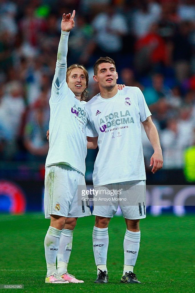 Mateo Kovacic of Real Madrid and Luka Modric of Real Madrid celebrate during the UEFA Champions League semi final, second leg match between Real Madrid and Manchester City FC at Estadio Santiago Bernabeu on May 4, 2016 in Madrid, Spain.
