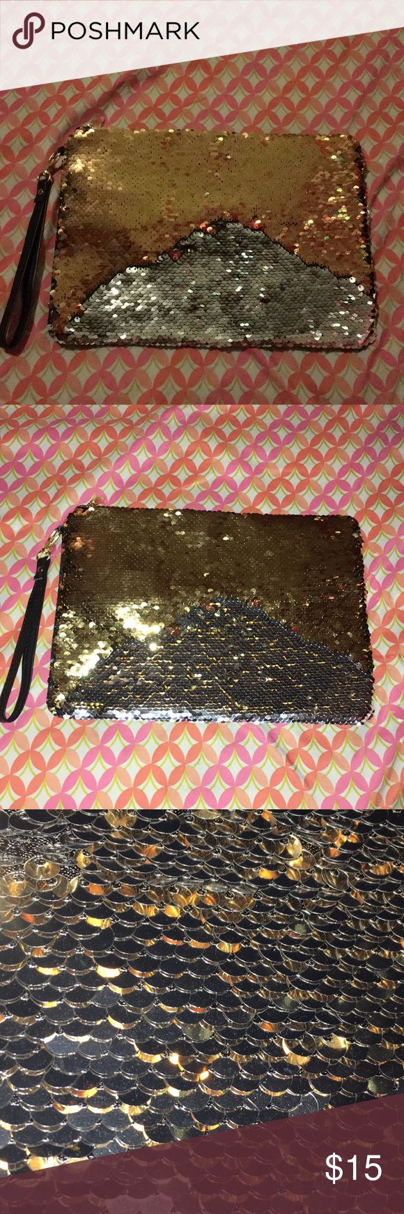 sequin clutch NWT sequin clutch it changes when you swipe/wipe it forward it's silver and gold Bags Clutches & Wristlets
